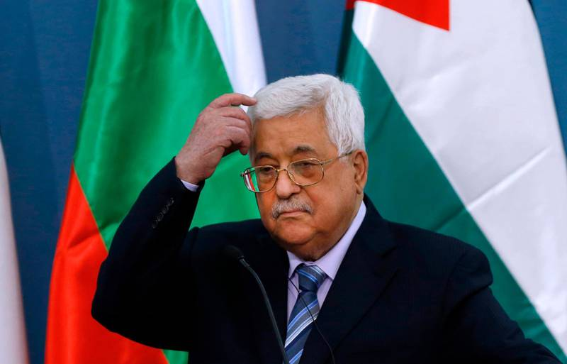 Palestinian Authority president Mahmoud Abbas scratches his head during a joint press conference with the visiting Bulgarian president at the Palestinian Authority headquarters in the West Bank city of Ramallah on March 22, 2018. / AFP PHOTO / ABBAS MOMANI