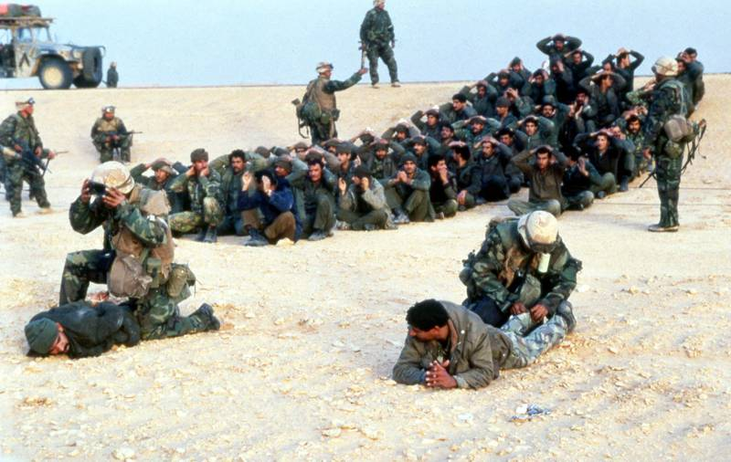 Iraqi prisoners of war sit in circles somewhere in the Saudi Arabian desert after giving themselves up to US troops in 1991. (AP Photo/Tannen Maury)