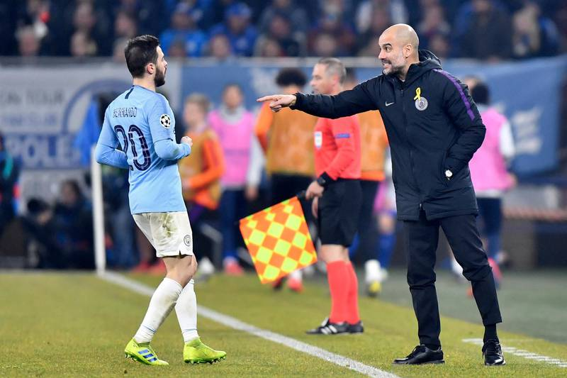 Manchester City coach Pep Guardiola, right, gives instructions from the side line to his player Bernardo Silva during the first leg, round of sixteen, Champions League soccer match between Schalke 04 and Manchester City at Veltins Arena in Gelsenkirchen, Germany, Wednesday Feb. 20, 2019. (AP Photo/Martin Meissner)