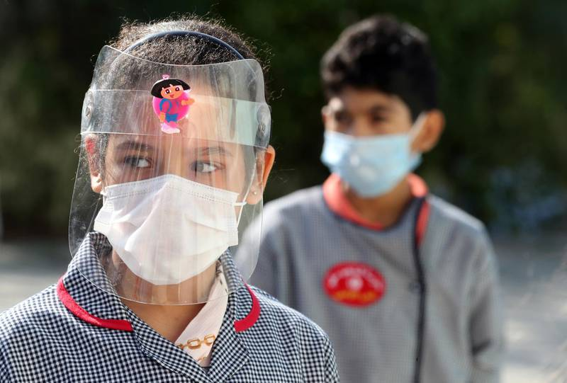 epa08715096 A Tunisian child wears a face shield in a school in Tunis, Tunisia, 02 October 2020. According to the Tunisian Ministry of Health on 02 October, COVID-19 cases are on the rise, which prompted the government to impose a night curfew in Monastir and Sousse provinces untill 15 October.  EPA/MOHAMED MESSARA