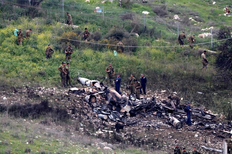 epaselect epa06511803 Israeli soldiers inspect the remains of an Israeli F-16 fighter jet that was shot down after a hit by Syrian anti-aircraft system, near the northern Israeli Kibbutz (collective community) of Harduf, 10 February 2018. An Israeli army spokesman said, Israeli army successfully intercepted an Iranian UAV (Unmanned Aerial Vehicle) that was launched from Syria and infiltrated Israeli airspace. In response, the army targeted Iranian locations in Syria. Israeli media reports that an Israeli F-16 warplane was shot down by Syrian anti-aircraft systems and the two crew ejected and parachuted to safety in Israel with the aircraft crashing in Israeli territory near Haifa.  EPA/ABIR SULTAN
