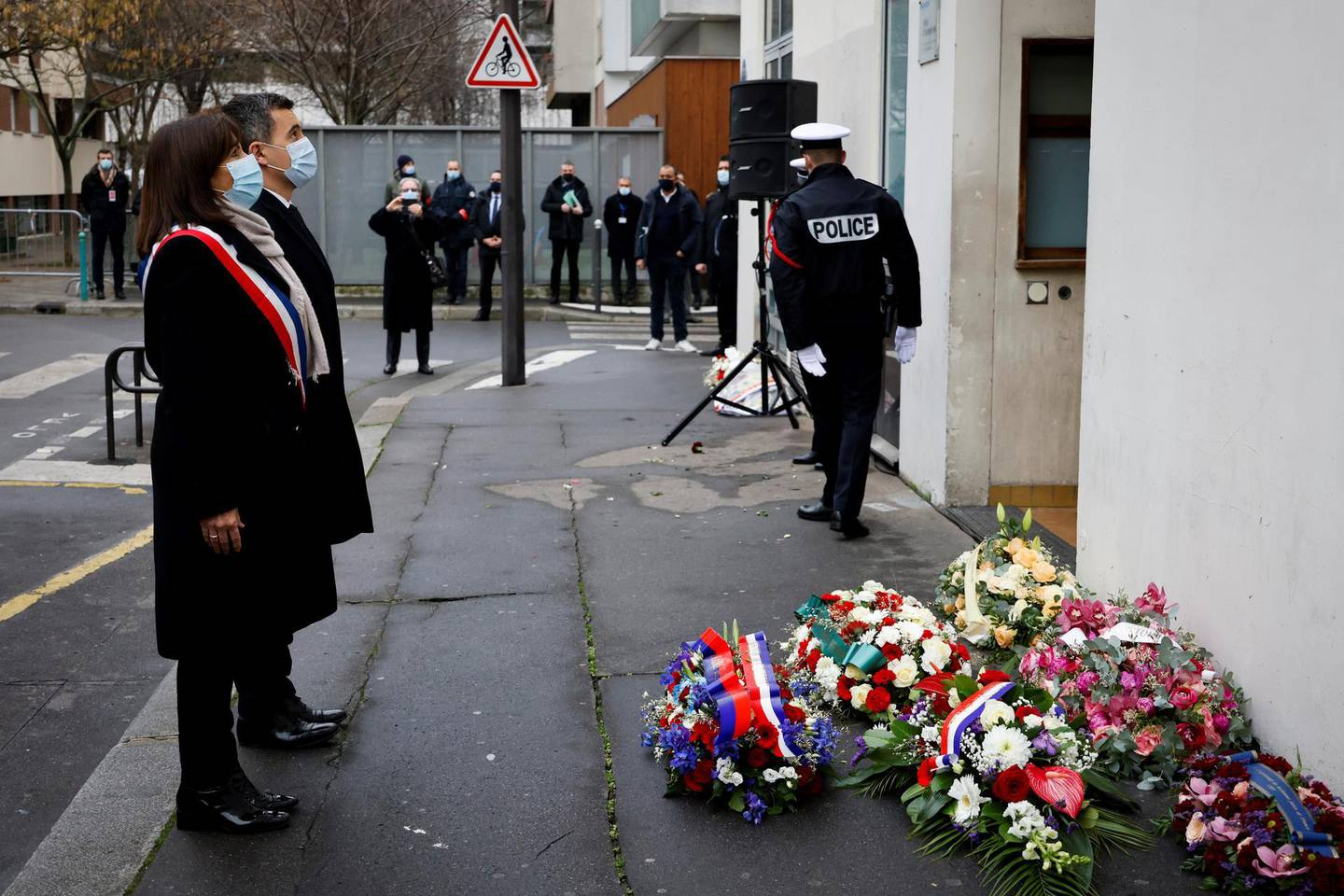 epa08924239 (From L) French Interior Minister Gerald Darmanin and Mayor of Paris Anne Hidalgo pay their respects outside Charlie Hebdo's former offices in Paris, France, 07 January 2021, during a ceremony marking the sixth anniversary of the jihadist attack of the satirical magazine that killed 12 people. The attack on the weekly -- with its long history of mocking Islam and other religions -- was the first in a series of assaults that have claimed more than 250 lives since 07 January 2015, mostly at the hands of young French-born jihadists.  EPA/THOMAS COEX / POOL  MAXPPP OUT