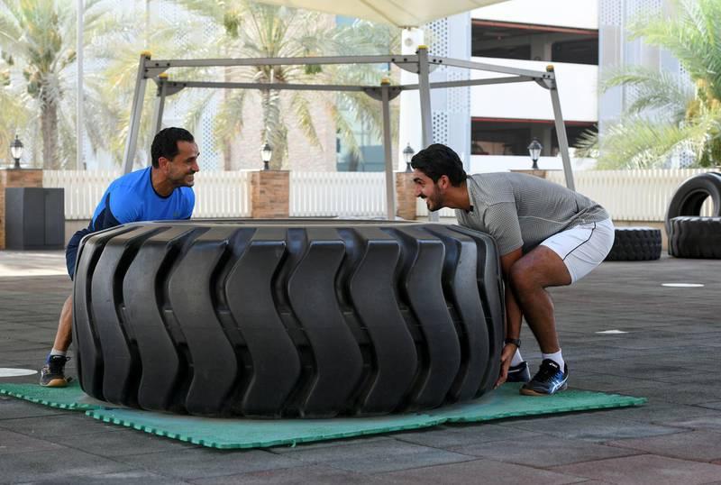 Nasser Al Ketbi-AD Nasser Al Ketbi, 23, works out with his guardian and mentor Hand Esaad, 50 at the Abu Dhabi Country Club on May 24, 2021. Khushnum Bhandari / The National  Reporter: Haneen Dajani News