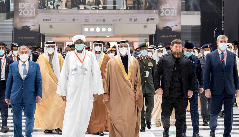 ABU DHABI, UNITED ARAB EMIRATES - February 21, 2021: HH Sheikh Mansour bin Zayed Al Nahyan, UAE Deputy Prime Minister and Minister of Presidential Affairs (front 3rd R), tours the 2021 International Defence Exhibition and Conference (IDEX), at Abu Dhabi National Exhibition Centre (ADNEC). Seen with HE Ramzan Kadyrov President of the Chechnya (front 2nd R).  ( Hamad Al Kaabi / Ministry of Presidential Affairs ) ---