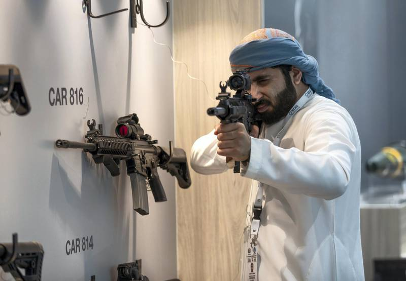 Abu Dhabi, U.A.E., February 18, 2019. INTERNATIONAL DEFENCE EXHIBITION AND CONFERENCE  2019 (IDEX) Day 2--    A exhibition visitor handles one of the Caracal CAR 816 Assault Rifles at the Caracal stalls.Victor Besa/The National