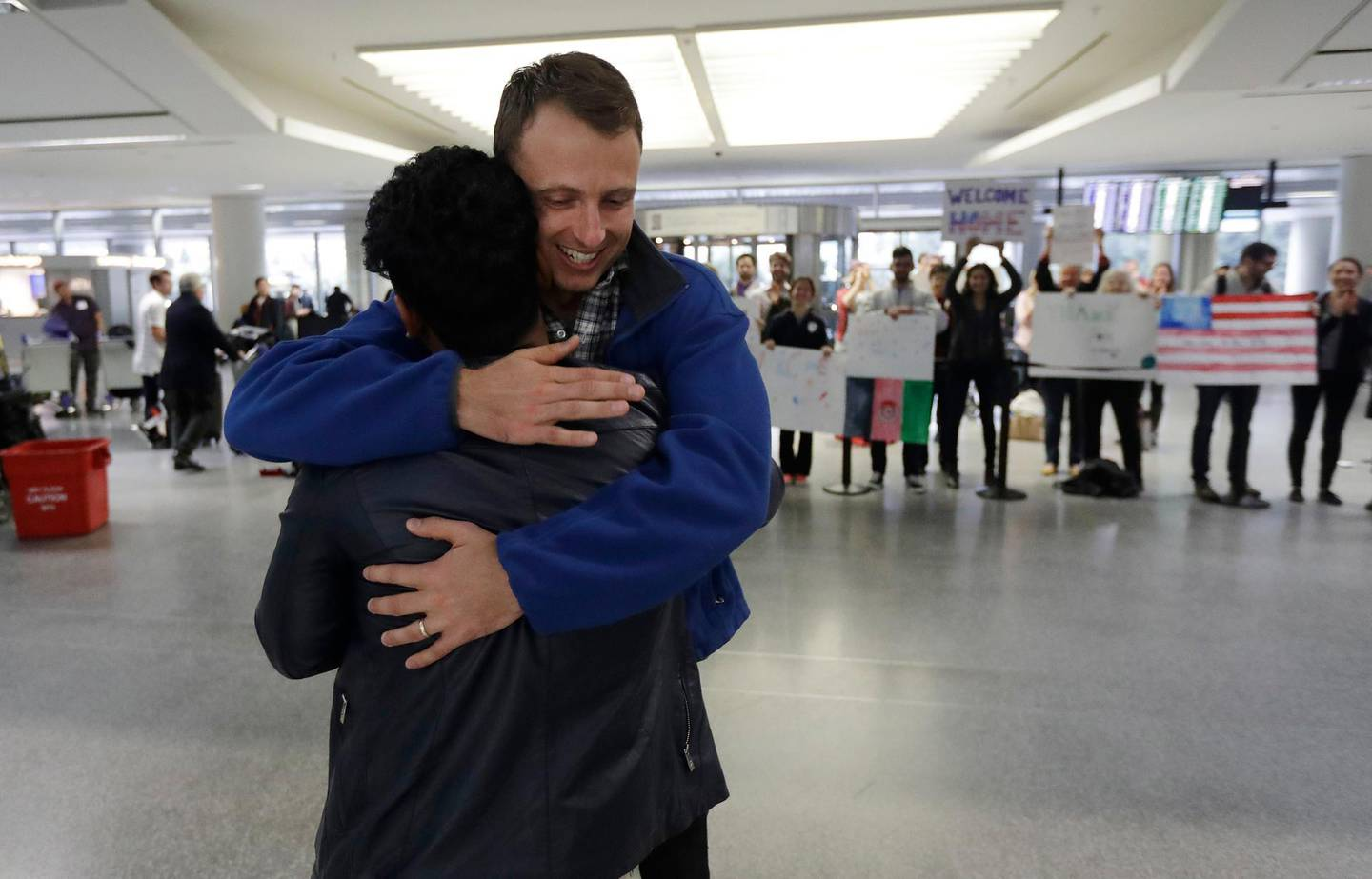 Army Capt. Matthew Ball, right, hugs his former interpreter Qismat Amin, as Amin arrives from Afghanistan, at San Francisco International Airport Wednesday, Feb. 8, 2017, in San Francisco. Ball welcomed Amin to the United States after buying him a plane ticket to ensure he would get in quickly amid concerns the Trump administration may expand its travel ban to Afghanistan. (AP Photo/Marcio Jose Sanchez)