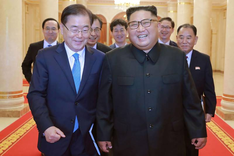 """This picture from North Korea's official Korean Central News Agency (KCNA) taken on September 5, 2018 and released on September 6, 2018 shows North Korean leader Kim Jong Un (R) meeting with South Korean president's special envoy Chung Eui-yong (L) in Pyongyang. - Kim Jong Un will meet the South's President Moon Jae-in at a summit in Pyongyang in September to discuss the nuclear disarmament, Seoul said on September 6. (Photo by KCNA VIA KNS / KCNA VIA KNS / AFP) / South Korea OUT / REPUBLIC OF KOREA OUT   ---EDITORS NOTE--- RESTRICTED TO EDITORIAL USE - MANDATORY CREDIT """"AFP PHOTO/KCNA VIA KNS"""" - NO MARKETING NO ADVERTISING CAMPAIGNS - DISTRIBUTED AS A SERVICE TO CLIENTS THIS PICTURE WAS MADE AVAILABLE BY A THIRD PARTY. AFP CAN NOT INDEPENDENTLY VERIFY THE AUTHENTICITY, LOCATION, DATE AND CONTENT OF THIS IMAGE. THIS PHOTO IS DISTRIBUTED EXACTLY AS RECEIVED BY AFP. /"""
