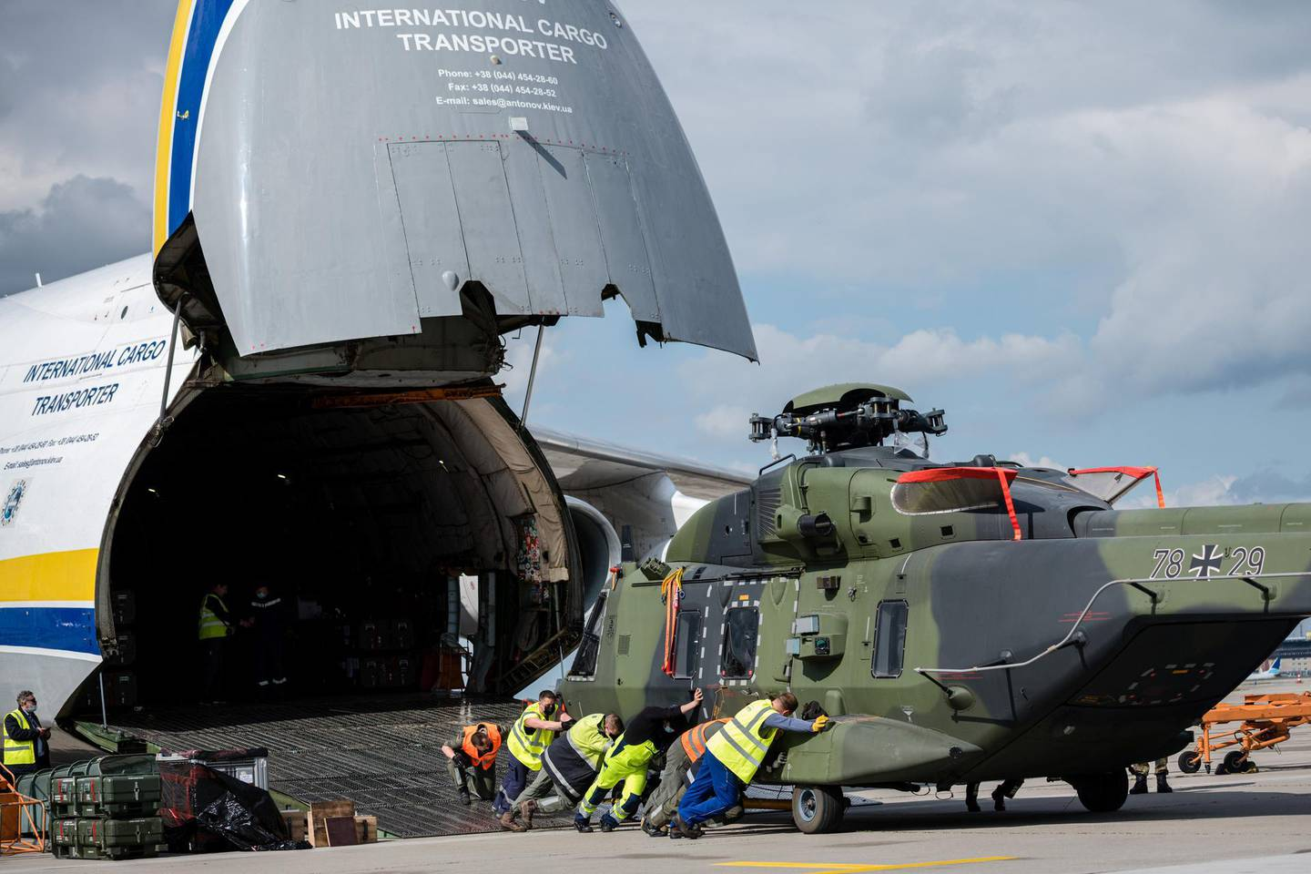LEIPZIG, GERMANY - MAY 18: Soldiers of the Bundeswehr, Germany's armed forces, unload an NH90 transport helicopter from a plane Antonov AN-124 for military transport arriving from Afghanistan at Leizpig Airport on May 18, 2021 in Leipzig, Germany. Germany has begun pulling out its approximately 1,100 remaining troops from Afghanistan in accordance with the general withdrawal of NATO forces. A total of 53 Bundeswehr soldiers have been killed in Afghanistan since 2002.  (Photo by Jens Schlueter/Getty Images)