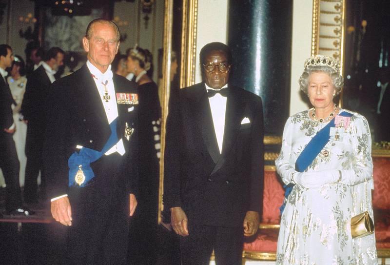 Mandatory Credit: Photo by Shutterstock (229453a)Robert Mugabe, Queen Elizabeth II and PR PHILIPQUEEN ELIZABETH II AND PRINCE PHILIP MEETING ROBERT MUGABE ZIMBABWEAN PRESIDENT - 1994