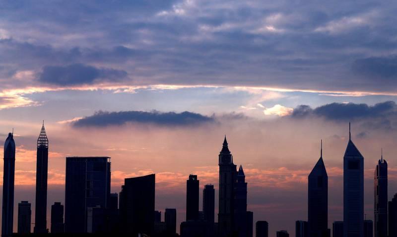 A picture taken on April 4, 2016, shows the skyline of Dubai during the sunset.         / AFP / KARIM SAHIB            / AFP / KARIM SAHIB    / AFP / KARIM SAHIB / AFP PHOTO / KARIM SAHIB