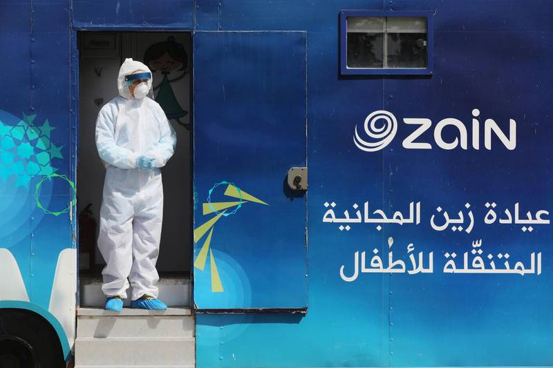 A Jordanian doctor stands at the entrance of one of the mobile clinics that are operated as part of initiative that was launched with the aim of providing Jordanians with field medical services, amid concerns over the spread of the coronavirus disease (COVID-19), in Amman, Jordan, March 30, 2020. Picture taken March 30, 2020. REUTERS/Muhammad Hamed
