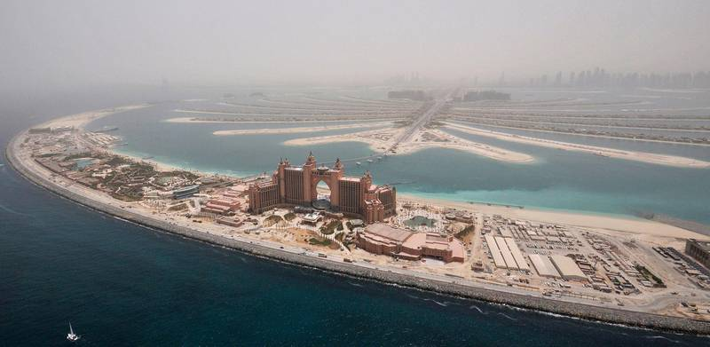 Atlantis, The Palm, currently under construction, is seen on the breakwater (crescent) of the Palm Jumeirah, May 3, 2008. The project is scheduled to be completed on September 24, 2008. REUTERS/Jumana El Heloueh (UNITED ARAB EMIRATES)