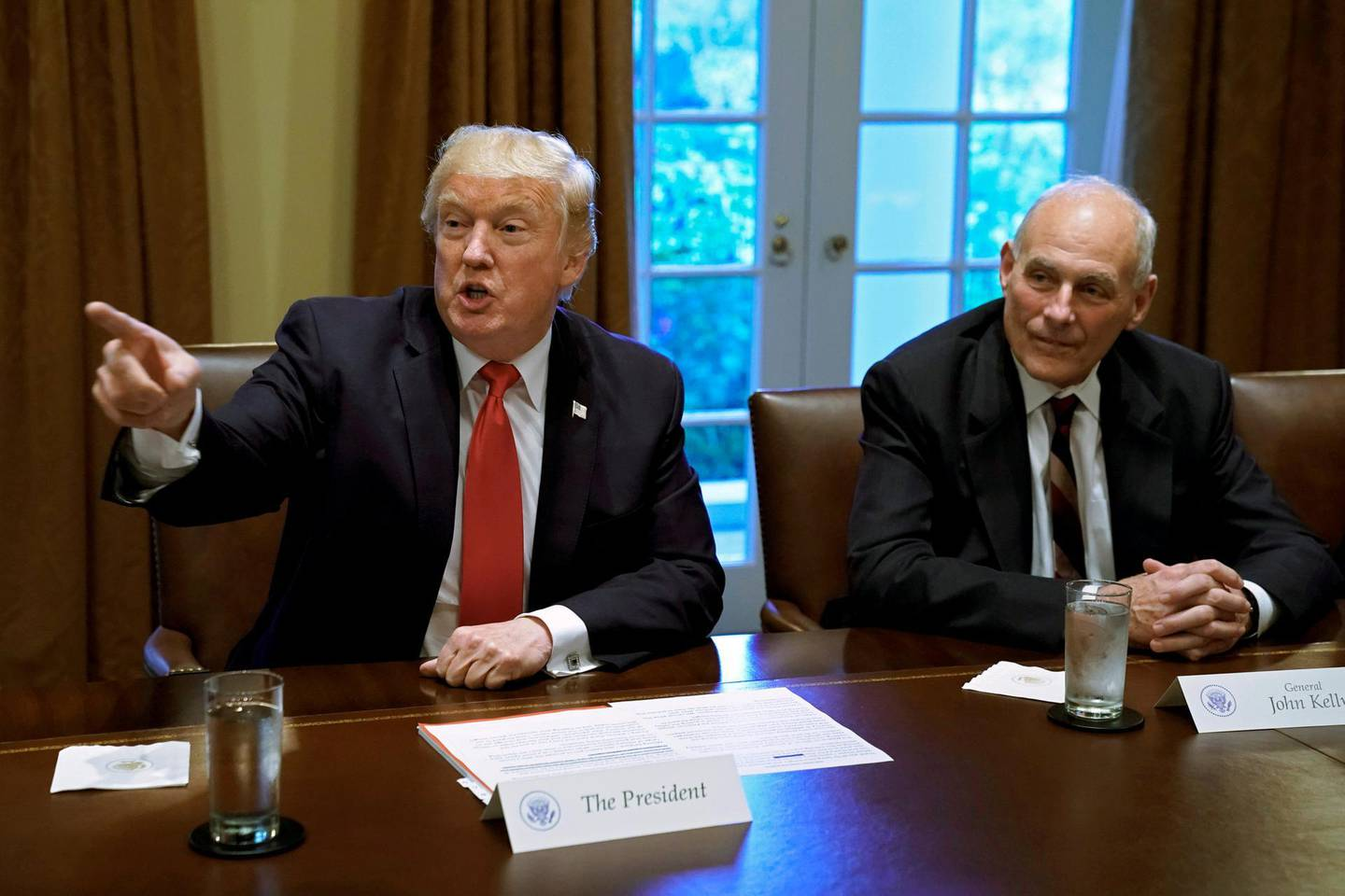 FILE PHOTO: U.S. President Donald Trump gestures next to White House Chief of Staff John Kelly during a briefing with senior military leaders at the White House in Washington, DC, U.S., October 5, 2017. REUTERS/Yuri Gripas/File Photo