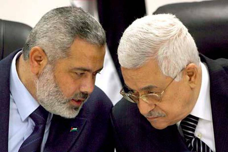 epa02705269 (FILE) A file photograph dated 18 March 2007 shows Palestinian President Mahmoud Abbas (R) with Palestinian Prime Minister Ismail Haniyeh during a government cabinet meeting in Gaza City in the Gaza Strip. After years of dispute, rival Palestinian factions Hamas and Fatah signed a reconciliation agreement mediated by Egypt in Cairo on 27 April 2011, Fatah officials confirmed. The details of the surprise agreement would be revealed in a press conference in Cairo later on Wednesday, Fatah official Azzam al-Ahmad, who led his groupÔs delegation in the talks said. The deal creates a timeframe for legislative and presidential elections and calls for the formation of an interim government, panArab network Al Arabiya reported earlier.  EPA/ALI ALI