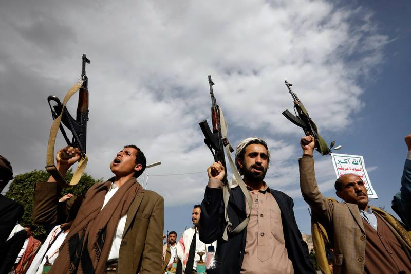 epa09038649 Houthi supporters shout slogans and hold up guns during a protest against the US administration and the Saudi-led coalition, in Sana'a, Yemen, 26 February 2021. Thousands of pro-Houthis Yemenis took to the streets of Sana'a to protest against Saudi-imposed stringent restrictions on commercial and fuel imports to the war-ridden country, accusing the US administration of continuing to support the Saudi-led military coalition fighting the Houthis since 2015.  EPA/YAHYA ARHAB