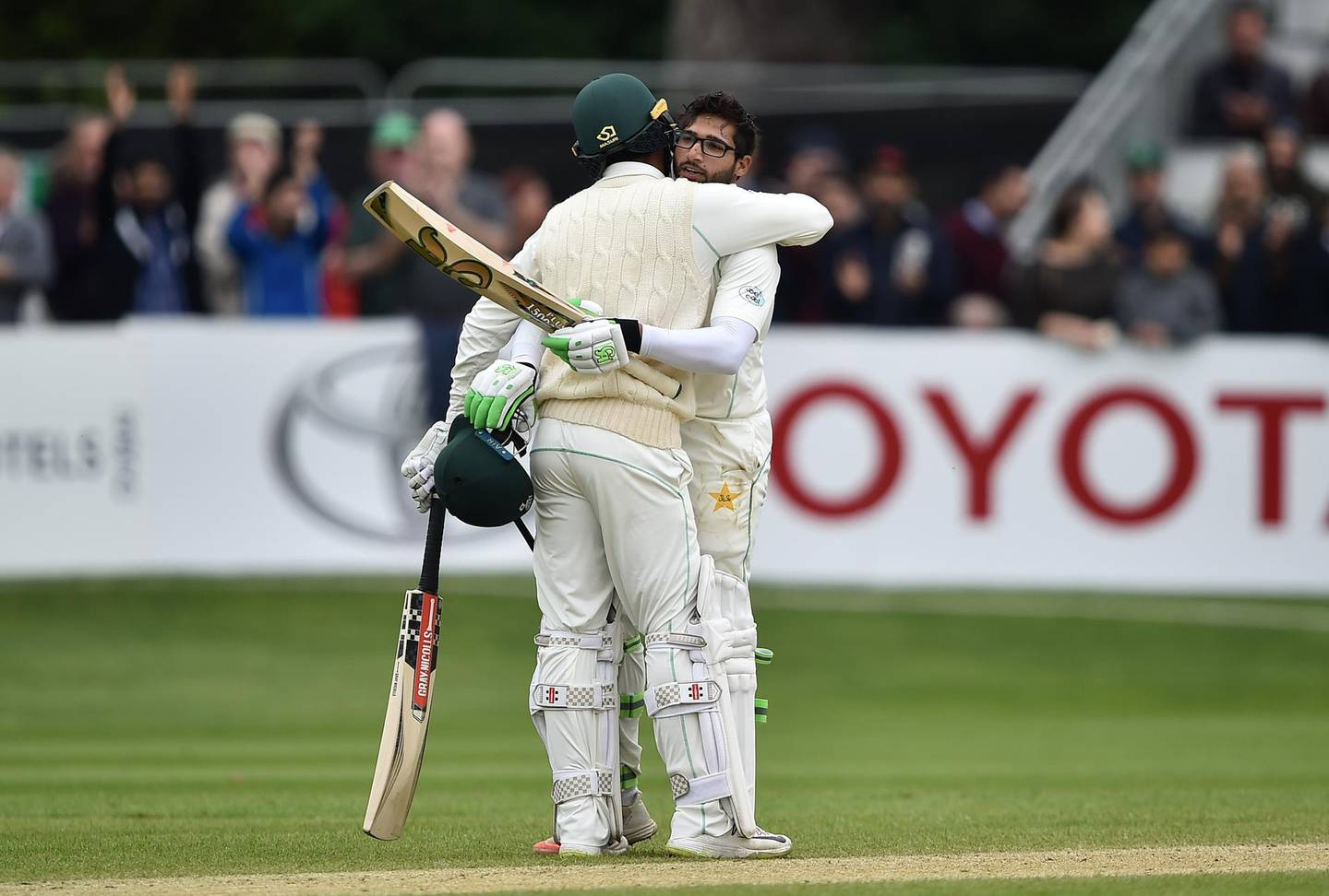 MALAHIDE, IRELAND - MAY 15: Imam ul-Haq of Pakistan is embraced by team mate Shadab Khan after scoring the winning run on the fifth day of the international test cricket match between Ireland and Pakistan on May 15, 2018 in Malahide, Ireland. (Photo by Charles McQuillan/Getty Images)