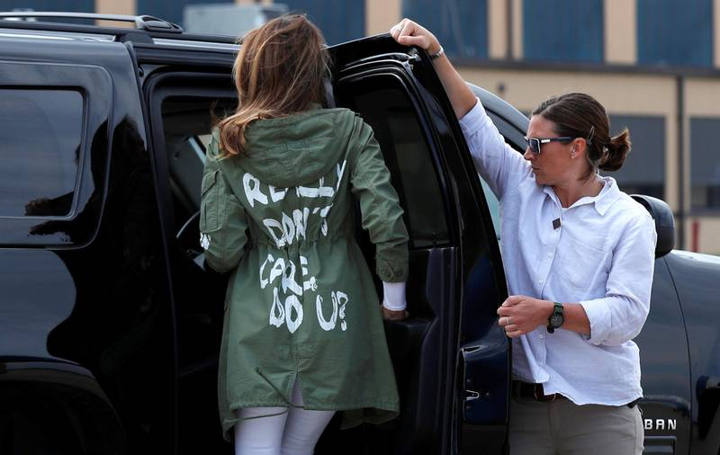 """U.S. first lady Melania Trump walks from her to her motorcade wearing a Zara design jacket with the phrase """"I Really Don't Care. Do U?"""" on the back as she returns to Washington from a visit to the U.S.-Mexico border area in Texas, at Joint Base Andrews, Maryland, U.S., June 21, 2018. REUTERS/Kevin Lamarque?"""