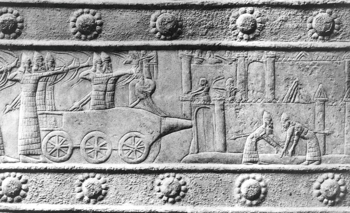 Circa 700 BC, Soldiers of the Assyrian army besieging a city, using a battering ram, on a wall-carving, Mesopotamia. (Photo by Hulton Archive/Getty Images)