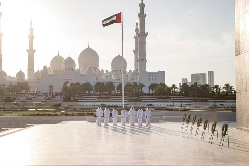 ABU DHABI, UNITED ARAB EMIRATES -November 30, 2016: (L-R) HH Sheikh Sultan bin Mohamed Al Qasimi, Crown Prince of Sharjah, HH Sheikh Saud bin Rashid Al Mu'alla, UAE Supreme Council Member and Ruler of Umm Al Quwain, HH Sheikh Mohamed bin Rashid Al Maktoum, Vice-President, Prime Minister of the UAE, Ruler of Dubai and Minister of Defence, HH Sheikh Humaid bin Rashid Al Nuaimi, UAE Supreme Council Member and Ruler of Ajman, HH Sheikh Mohamed bin Zayed Al Nahyan, Crown Prince of Abu Dhabi and Deputy Supreme Commander of the UAE Armed Forces, HH Sheikh Hamad bin Mohamed Al Sharqi, UAE Supreme Council Member and Ruler of Fujairah, and HH Sheikh Saud bin Saqr Al Qasimi, UAE Supreme Council Member and Ruler of Ras Al Khaimah, stand for the national anthem during a Commemoration Day ceremony, at Wahat Al Karama. ( Ryan Carter / Crown Prince Court - Abu Dhabi ) *** Local Caption ***  20161130RC_C165137.jpg
