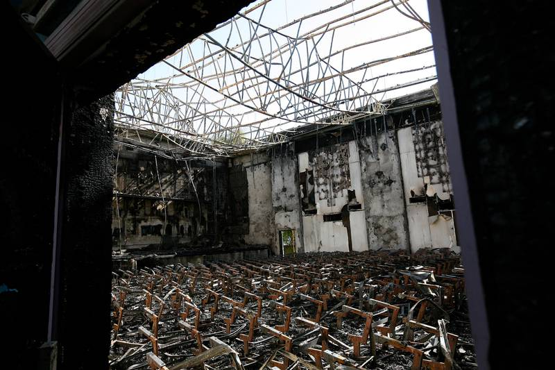 DUBAI, UNITED ARAB EMIRATES – Dec 22: Inside view of the Al Nasr Cinema after fire destroyed the complex yesterday (on sunday 21st Dec)  in Dubai. (Pawan Singh / The National) Story by Praveen *** Local Caption ***  PS06- ALNASR CINEMA.jpgPS06- ALNASR CINEMA.jpg