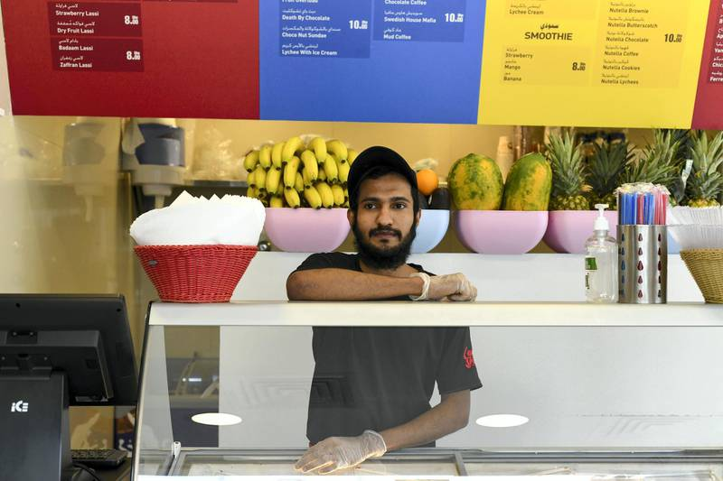 Abu Dhabi, United Arab Emirates - Manor Mohammed, 23, originally from India works at a milkshake cafe in Tourist Club Area for a year and a half. Khushnum Bhandari for The National