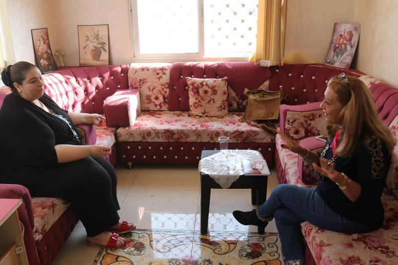 Asma Hijazin (left) discusses women's political prospects with candidate for parliament Wafa Yousif Tarawneh (right) at her makeshift office in Karak, southern Jordan on October 31, 2020. Taylor Luck for The National