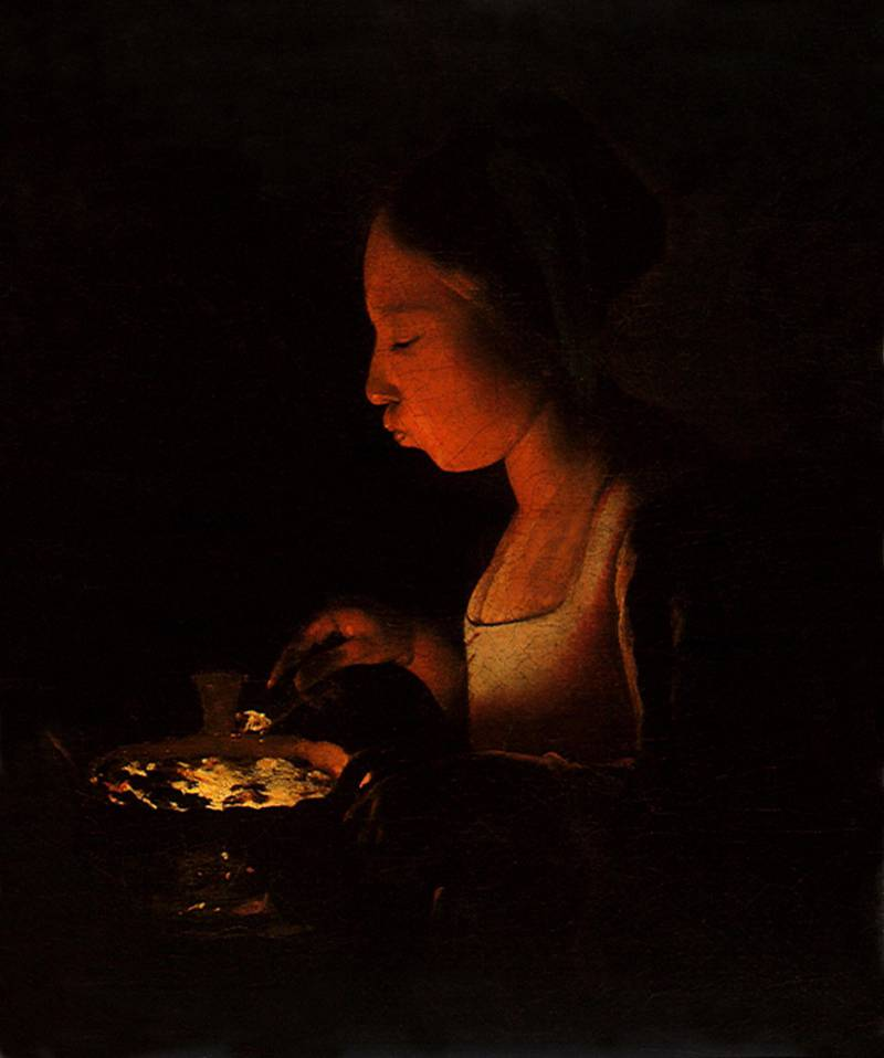 MKNJ5Y A Girl Blowing on a Brazier. Image shot 1645. Exact date unknown. Alamy