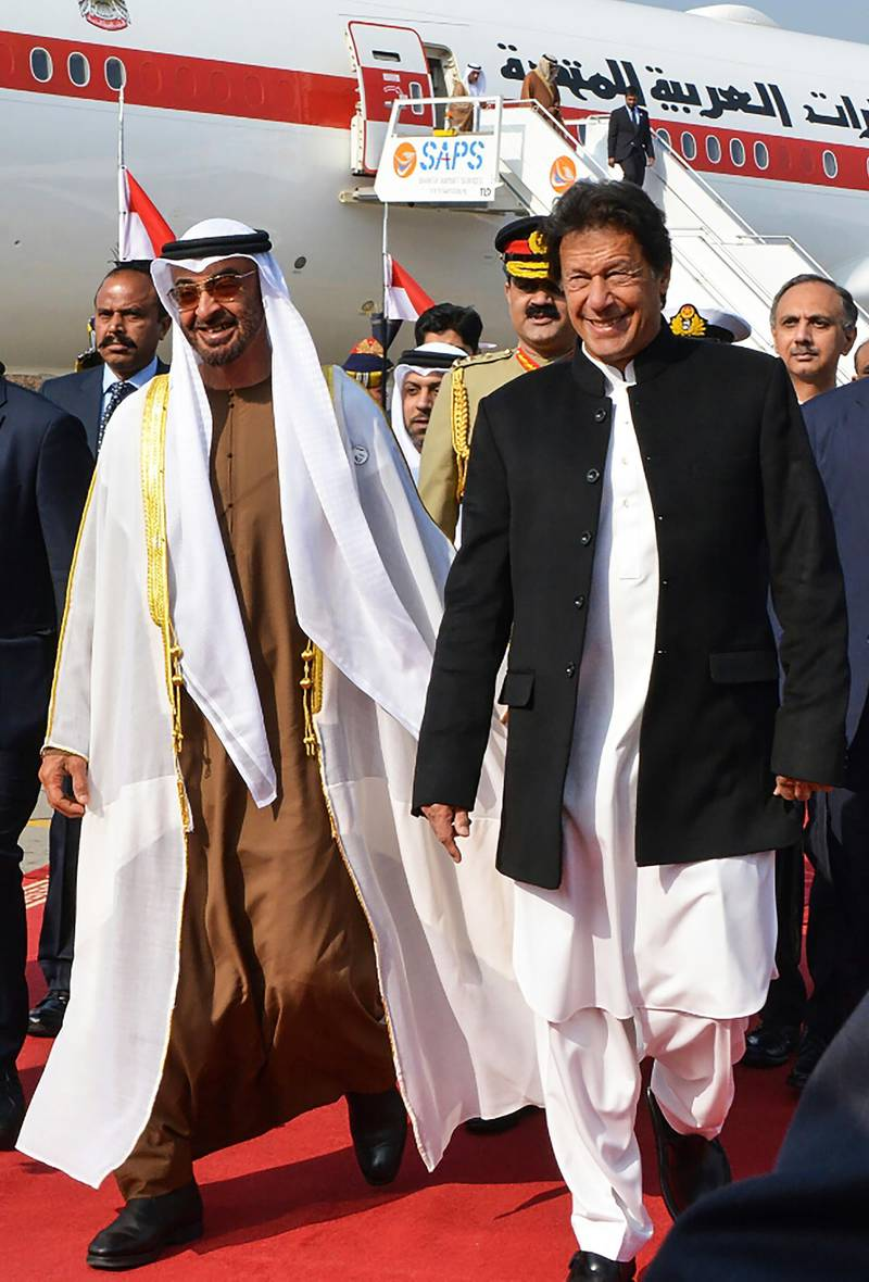 Pakistan's Prime Minister Imran Khan (R) walks with Abu Dhabi's Crown Prince Sheikh Mohamed bin Zayed Al-Nahyan (L) upon his arrival at the military Nur Khan Air Force base in Islamabad on January 6, 2019. The red carpet was rolled out for Abu Dhabi's Crown Prince Sheikh Mohamed bin Zayed Al-Nahyan in Islamabad on January 6, just weeks after his country offered $3 billion to support Pakistan's battered economy, local media said. / AFP / STR
