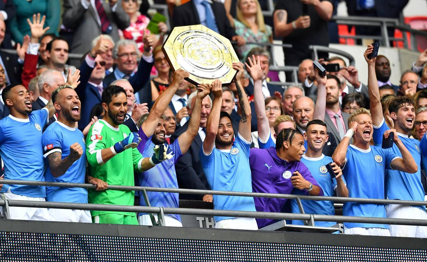FILE PHOTO: Soccer Football - FA Community Shield - Manchester City v Liverpool - Wembley Stadium, London, Britain - August 4, 2019  Manchester City's Sergio Aguero and David Silva celebrate winning the FA Community Shield with team mates   REUTERS/Dylan Martinez/File Photo