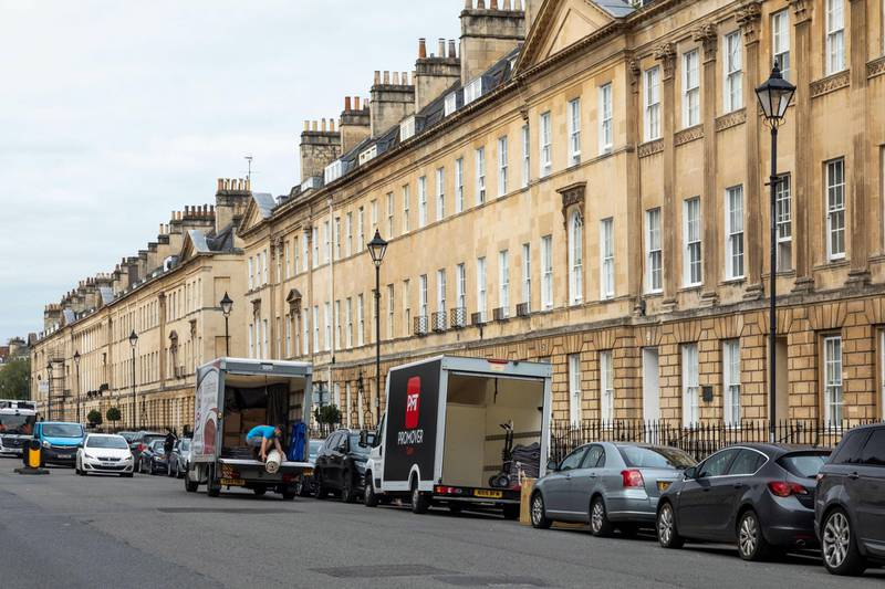 2CNF52C Removal vans in Great Pulteney Street, City of Bath, Somerset, England, UK