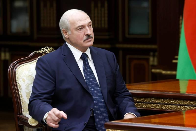 Belarusian President Alexander Lukashenko listens to the head of the Investigative Committee Ivan Naskevich during their meeting in Minsk, Belarus, Monday, Sept. 7, 2020. (Nikolai Petrov, BelTA via AP)