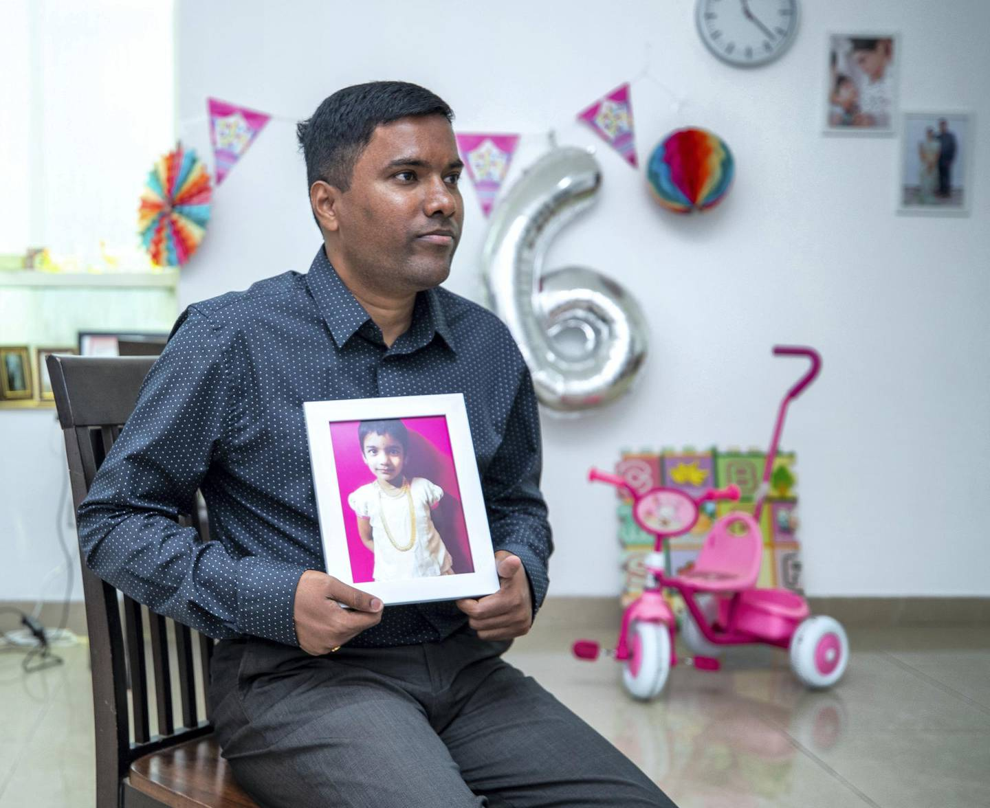 A father donates the organs of his daughter. Aruna Kumar holds some memories of his daughter, Bhamani at his home in central Abu Dhabi on May 27, 2021. Victor Besa / The National.Reporter: Shireena Al Nowais for News