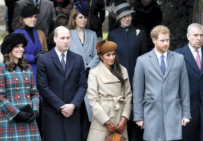 Britain's Catherine, Duchess of Cambridge, (L) and Britain's Prince William, Duke of Cambridge, (2L), US actress and fiancee of Britain's Prince Harry Meghan Markle (2R) and Britain's Prince Harry (R) stand together as they wait to see off Britain's Queen Elizabeth II after attending the Royal Family's traditional Christmas Day church service at St Mary Magdalene Church in Sandringham, Norfolk, eastern England, on December 25, 2017. (Photo by Adrian DENNIS / AFP)