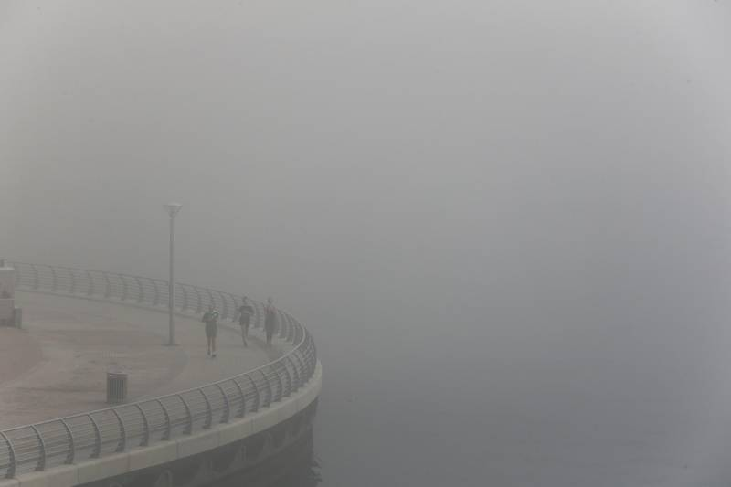 Dubai, United Arab Emirates, Mar 06, 2014 - Early morning fog at Dubai Marina. ( Jaime Puebla / The National Newspaper )