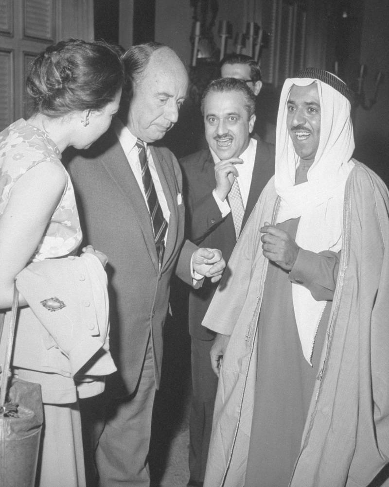 US Amb. to UN Adlai Stevenson standing beside unident. woman & w. Talat Ghoussein, Charge d'Affaires of Kuwait Embassy (2R) & Kuwaiti For. Min. Sheikh Sabah Al-Ahmad Al-Sabah, at Kuwaiti reception at UN.  (Photo by Leo Rosenthal/Pix Inc./The LIFE Images Collection via Getty Images/Getty Images)