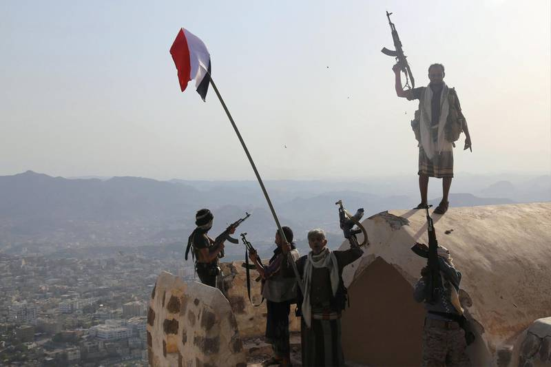 Fighters loyal to Yemen's exiled President Abedrabbo Mansour Hadi stand on top of the Al-Qahira Castle, located on the highest mountain in Yemen's third city Taez, after they seized it from rebel fighters on August 18, 2015. Pro-government and rebel forces have for months fought over Taez, seen as crucial gateway to the rebel-held capital Sanaa. AFP PHOTO / AHMAD AL-BASHA / AFP PHOTO / AHMAD AL-BASHA