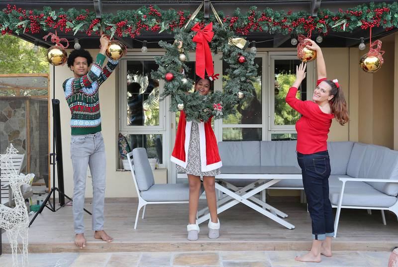 DUBAI, UNITED ARAB EMIRATES , December 16 – 2020 :- Karen Hammond with her daughter Lydia Hammond (13 years old) and son Isaac Hammond (19 years old) at her villa in Al Reem 2, Arabian Ranches in Dubai. She is from UK and will be in Dubai for Christmas due to pandemic and travel restrictions. ( Pawan Singh / The National ) For News/Online. Story by Gill