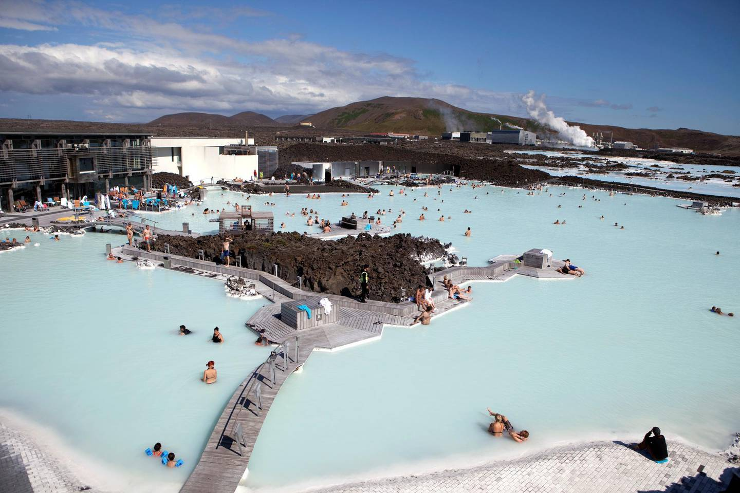 Looking down at locals and tourists in the thermal pools at the Blue Lagoon Spa just outside of Reykjavik, Iceland. Iceland is one of the most isolated countries at the world and has been drawing adventure tourists for years and continues to be one of the most visually stunning places in the world. (Photo by Ryan Pyle/Corbis via Getty Images)