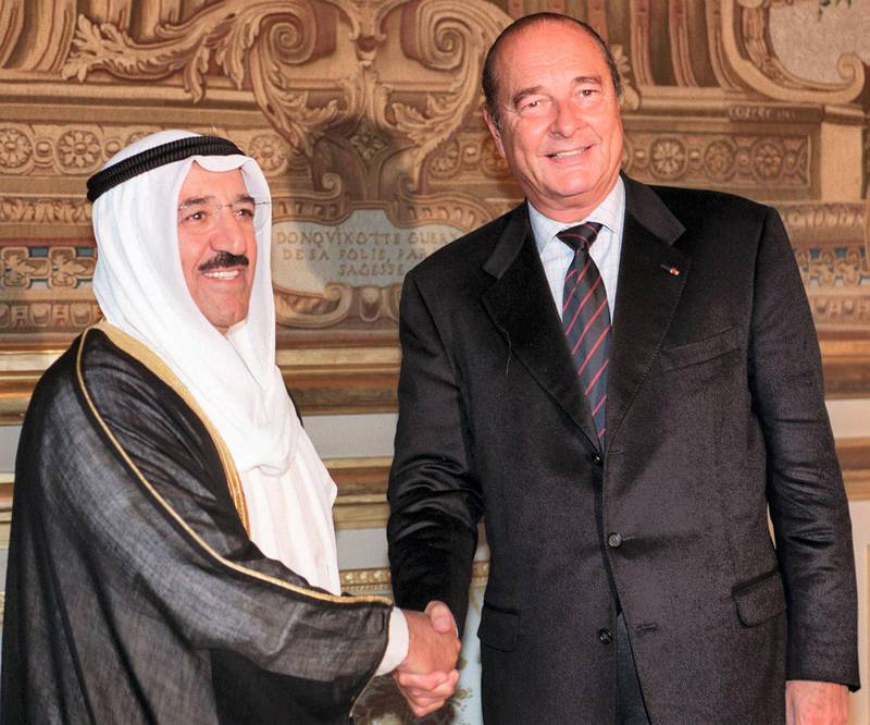 French President Jacques Chirac (R) shakes hands with Kuwaiti Vice Prime Minister and Foreign Minister Sheikh Sabah al-Ahmad al-Sabah at the Elysee Palace in Paris 07 September. Al-Sabah is in France on a two-day official visit. (Photo by ERIC FEFERBERG / POOL / AFP)