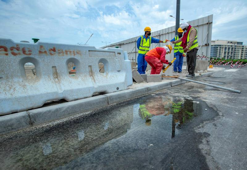 Puddles from the brief rainshowers gather on the gutters and roads in Saadiyat Island on April 28, 2021.  Victor Besa / The National.
