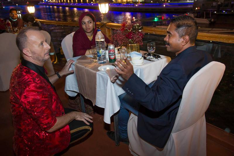 Dubai, United Arab Emirates - Richard the man behind the Big Ticket draw with Bouchra Yamani talking to  the winners at the gathering of of Abu Dhabi Big Ticket winners at Alexandra Dhow Cruise, Dubai Marina.  Leslie Pableo for The National for Sarwat Nasir's story