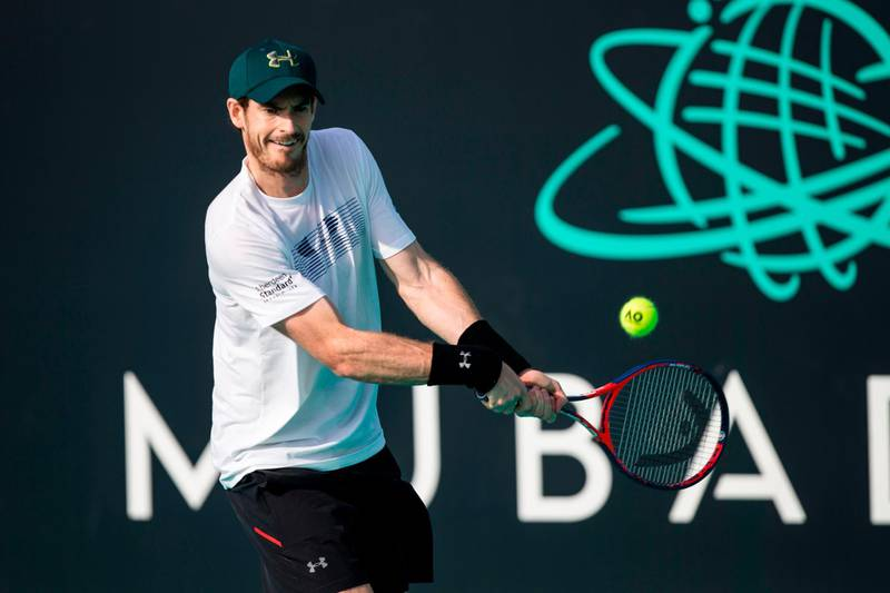 (FILES) This file photo taken on December 28, 2017 shows Andy Murray of Great Britain taking part in a tennis practice session in Abu Dhabi prior to heading to compete in the Australian Open on the sidelines of the Mubadala World Tennis Championship.  Andy Murray announced he had hip surgery in Australia on January 8, 2018 and is hoping to return to competitive tennis in time for the grasscourt season midway through the year. / AFP PHOTO / NEZAR BALOUT