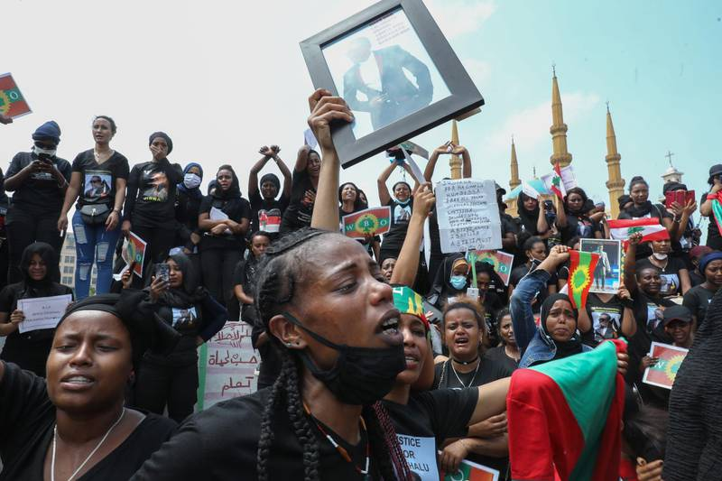 Members of the Oromo Ethiopian community in Lebanon take part in a demonstration to protest the death of musician and activist Hachalu Hundessa, in the capital Beirut on July 5, 2020. - Hundessa was shot and killed in the Ethiopian capital Addis Ababa on June 29, 2020. His death has sparked ongoing protests around the world. (Photo by ANWAR AMRO / AFP)