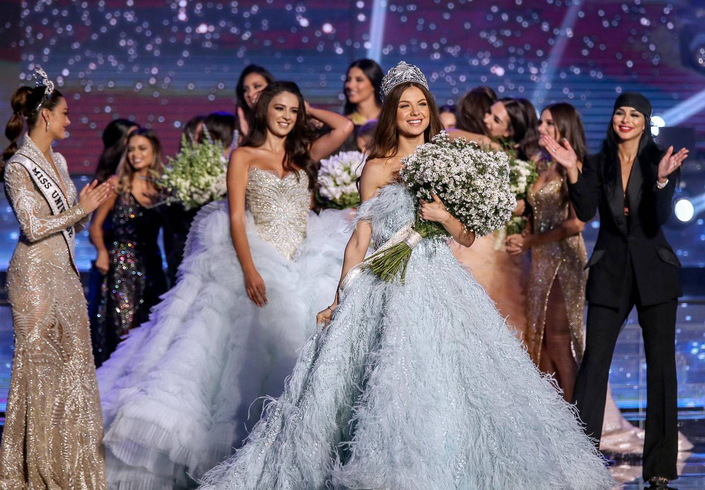epa07060480 Lebanese Maya Reaidy (C) poses after winning the Miss Lebanon 2018 beauty pageant, next to Lebanese-American actress Miss USA 2010 Rima Fakih (R) and Miss Universe 2017 Demi-Leigh Nel-Peters (L) at forum De Beirut in Beirut, Lebanon, 30 September 2018.  EPA/NABIL MOUNZER