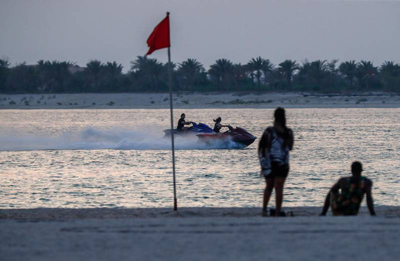 Abu Dhabi, United Arab Emirates, August 14, 2020.  The sun sets on beautiful Corniche on an active Friday as Covid-19 restrictions ease.Victor Besa /The NationalSection:  NAFor:  Standalone/Stock Images