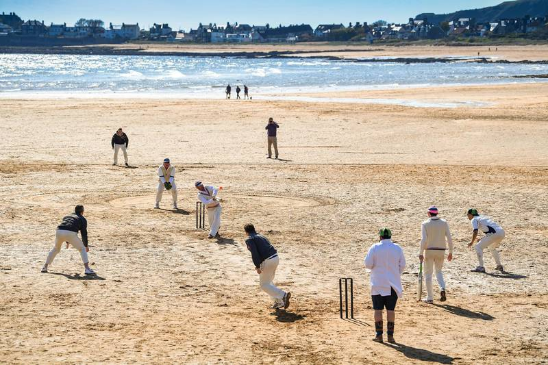 ELIE, SCOTLAND - MAY 12: Cricket players from the Ship Inn and Borderers teams hold the first match of the season at the beach on May 12, 2019 in Elie, Scotland. The Ship Inn pub is the only cricket team in the United Kingdom to play their matches on a beach. Over the course of a season they hold regular fixtures against Scottish clubs as well as touring teams from across the world. (Photo by Jeff J Mitchell/Getty Images)