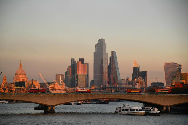 St. Paul's Cathedral and buildings of the City of London financial district are seen as buses cross Waterloo bridge at sunset, amid the outbreak of the coronavirus disease (COVID-19), on the first day of a newly imposed lockdown, in London, Britain November 5, 2020. REUTERS/Toby Melville