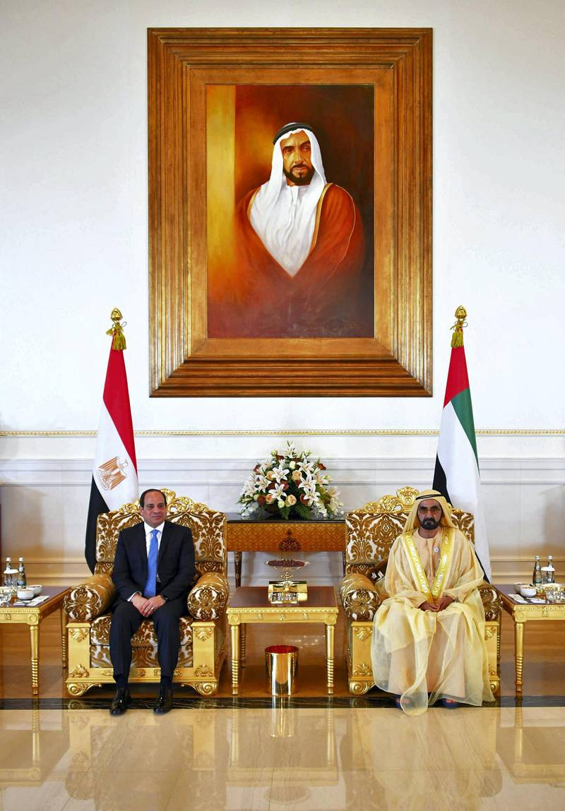 """A handout picture released by the Egyptian Presidency on February 6, 2018 shows Egyptian President Abdel Fattah al-Sisi (L) being received by Sheikh Mohammed bin Rashid Al-Maktoum, Vice President and Prime Minister of the United Arab Emirates and ruler of Dubai, in the Emirati capital Abu Dhabi. (Photo by - / EGYPTIAN PRESIDENCY / AFP) / === RESTRICTED TO EDITORIAL USE - MANDATORY CREDIT """"AFP PHOTO / HO / EGYPTIAN PRESIDENCY' - NO MARKETING NO ADVERTISING CAMPAIGNS - DISTRIBUTED AS A SERVICE TO CLIENTS =="""