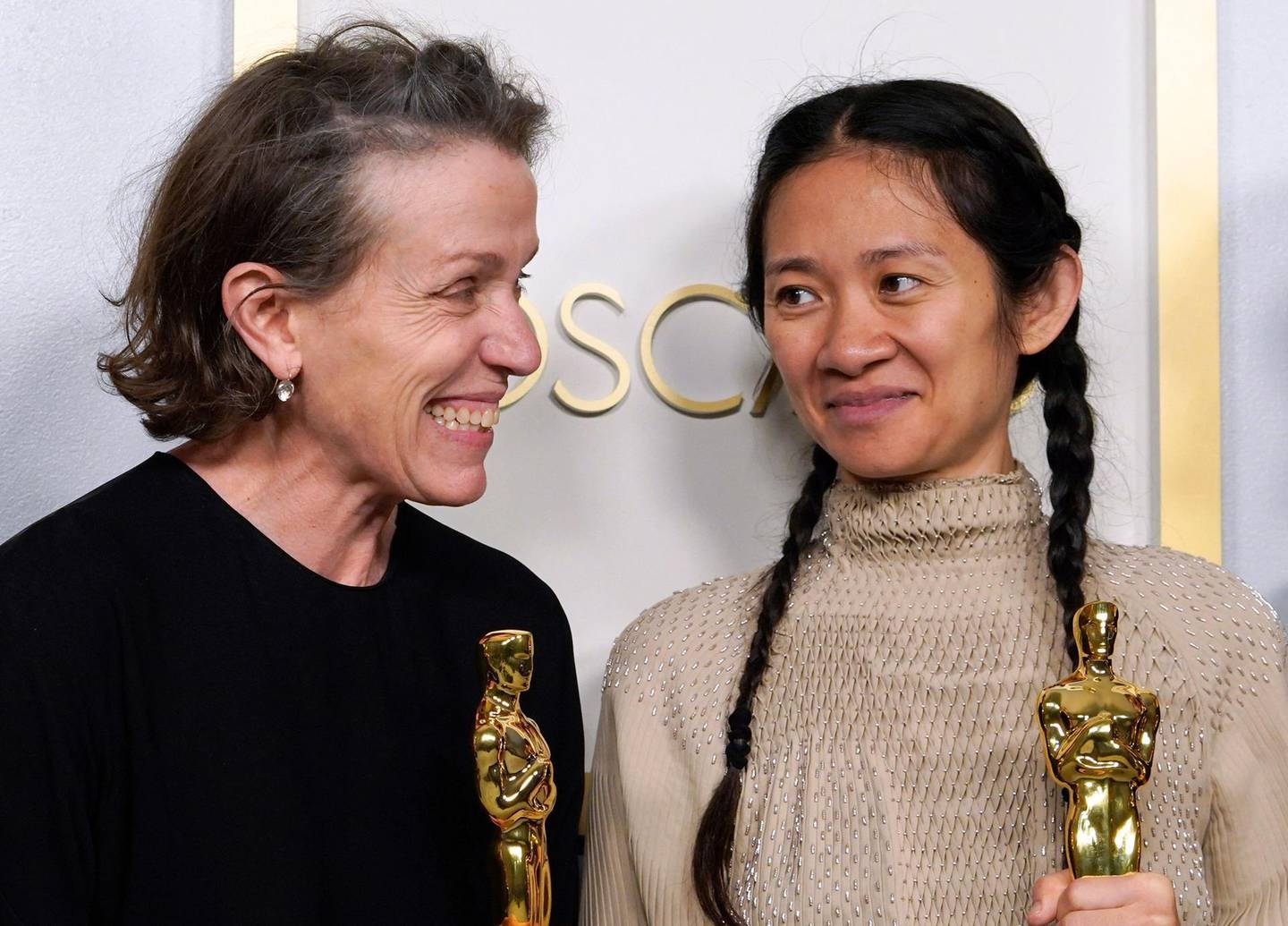 """Producers Frances McDormand and Chloe Zhao, hold the Oscar for Best Picture for """"Nomadland"""" as they pose in the press room at the Oscars on April 25, 2021, at Union Station in Los Angeles.  McDormand also won for Actress in a Leading Role for """"Nomadland"""" and Chloe Zhao wond Directing for """"Nomadland"""" -   / AFP / POOL / Chris Pizzello"""