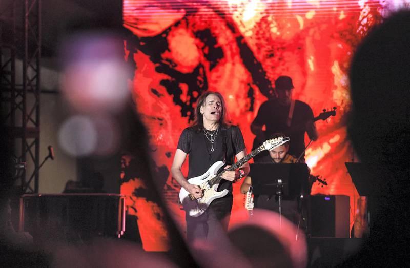 Abu Dhabi, United Arab Emirates - Steve Vai, American guitarist, composer singer, songwriter, and producer performs at the opening night of Berklee, Abu Dhabi, Al Saadiyat. Khushnum Bhandari for The National